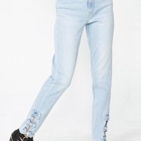 721 High Rise Bow Skinny Jeans