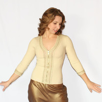 70s knit top. Champagne gold. zip up ribbed top by Cache. Size Small. Gold lurex crochet trim. Beige gold.