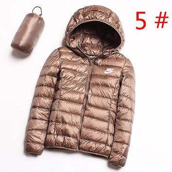 NIKE Autumn And Winter Bust Side Letter Hook Print Women Keep Warm Hooded Long Sleeve Down Jacket Coat