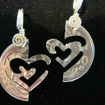 Friendship Pendant Puzzle, Two Interlocking Hearts cutout of a silver coin