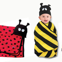 The Spoon Sisters Swaddle Blanket and Cap Set
