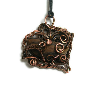 Wire wrapped heart pendant with old wood