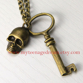 a vintage style house key with a pirate skull Necklace