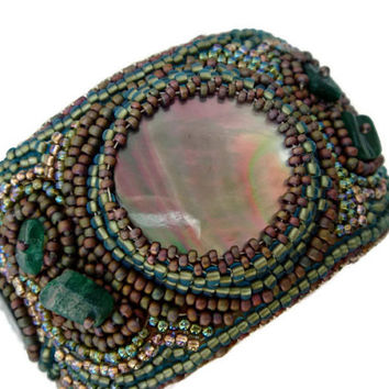Bead embroidery cuff bracelet with a Mother of Pearl cabochon. Seed beads jewelry
