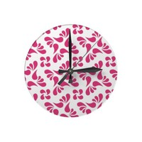 Cabaret Red Fuchsia And White Graphic Art Pattern Clocks from Zazzle.com