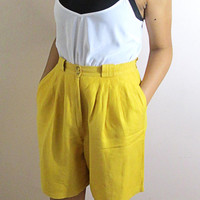 The Beach Babe. Vintage Renewals. Yellow High Waisted Shorts with a Pleated Waist. Knee Length Shorts. Size Small