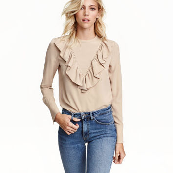 H&M Ruffled Blouse $24.99