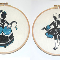 Set of two unframed completed cross stitch embroidered romantic silhouette images