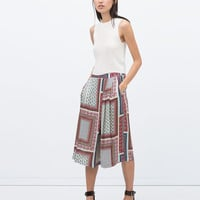 PRINTED WIDE-LEG TROUSERS New