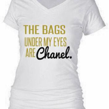 THE BAGS UNDER MY EYES ARE CHANEL.