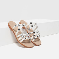 FLAT LEATHER STUDDED SANDALS