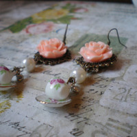 Victorian/ Steampunk, rose and teacup dangle earrings.