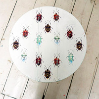 Cute folding coffee table covered in vintage beetles with turquoise trim