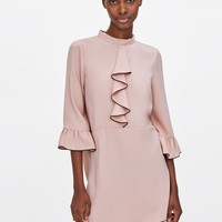 DRESS WITH CONTRASTING RUFFLES DETAILS
