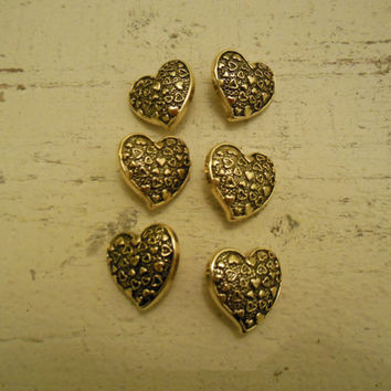 Set of 6 gold, heart shaped buttons for crafting or sewing. Crafts/Destash