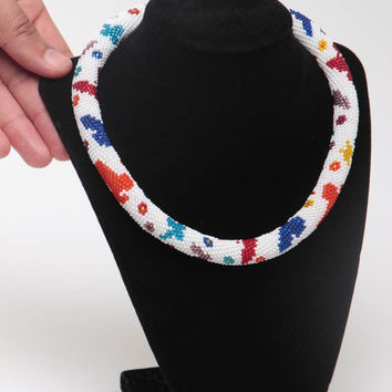 Handmade designer white beaded cord necklace with colorful floral pattern
