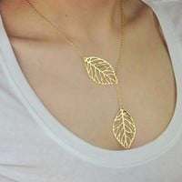 ON SALE - Leaf Tassle Necklace in Yellow Gold or White Gold