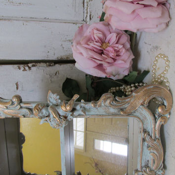 Ornate wall shelf French blue distressed shabby chic adorned with cherubs mirrored back wall decor Anita Spero