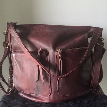 Shoulder tote made from super soft lambskin.Converts to backpack.Handmade,soft,perfect for a laptop or travel bag.Leather backpack tote bag