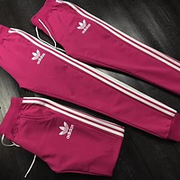 ADIDAS Clover counter classic men and women models casual fashion beam foot harem pants F-AA-XDD