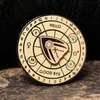 "Spirit Board Spinner ""Vintage Beige"" enamel pin from Never Not Clever"