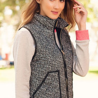 Grey and black vest with pockets