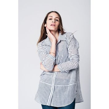 White hi lo shirt with black vertical stripes