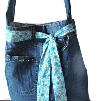 Upcycled denim jeans crossbody purse. Unique diaper bag decorated with a lace and colorful beads