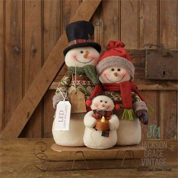 Snow Lodge- Snowman Family on Sled with LED Candle