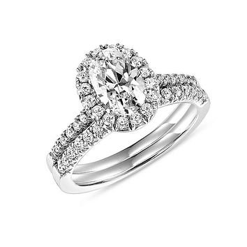1.20 CT. T.W. Oval Diamond Halo Bridal Engagement Ring Set in 14K White Gold