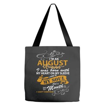 I'm an august woman I was born with my heart Tote Bags