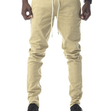 The James Tapered Ankle Zip Pants in Khaki