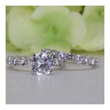 Sterling Silver 2.00 Ct. Eternity Cubic Zirconia Engagement Ring Set