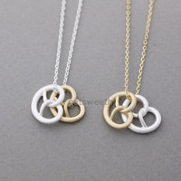 Tiny pretzel necklace in gold silver