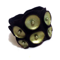 Leather bracelet. Peridot and black pod leather cuff. Leather jewelry