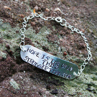 "The Hunger Games Bracelet. ""Hope is the Only Thing Stronger Than Fear."" Personalized Handstamped Bracelet"