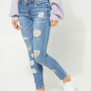 Medium Wash Midrise Destroyed Skinny Jeans in Regular