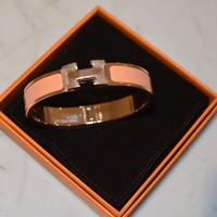 HERMES Clic H Bracelet, Rose gold plated hardware Orange Papaye Enamel GM