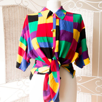 Plus size, oversize colorful, rainbow square women shirt with metal gold buttons. Geometric, abstract pattern, rainbow checkered.