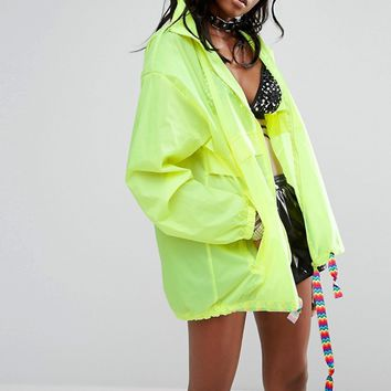 Reclaimed Vintage Inspired Festival Neon Rain Trench Jacket With Concealed Hood at asos.com