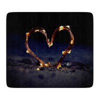 Cool heart shape made from lighting on beach sand cutting board