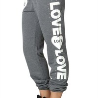 roll leg pant features a love heart love puff print down the leg