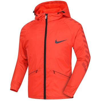NIKE spring and autumn thin sports and leisure running men's hooded loose breathable windbreaker Red
