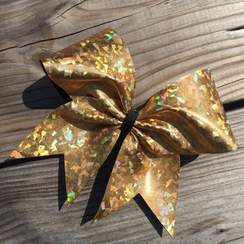 Holographic metallic bow in gold.