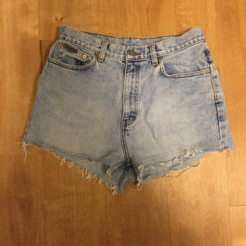 Classic highwaisted denim cutoffs. Calvin Klein. Size 8.