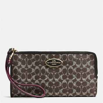 COACH L-Zip Wallet in Embossed Signature Canvas at Von Maur