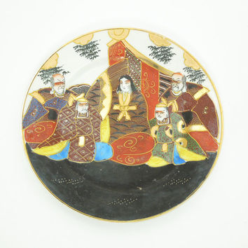 Japanese Satsuma plate with hand-painted immortals in black gold blue white red - Made in Japan
