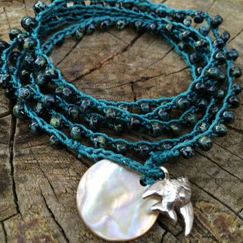 Black picasso TOHO seed bead wrap bracelet, cerulean cord, Hill Tribe Silver fine silver fish charm, mother of pearl button disc closure