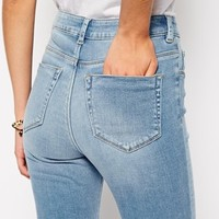 ASOS TALL Ridley High Waist Skinny Jeans in Real Wash With Ripped Knee