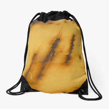'Rusty Steel Yellow // Acier jaune rouillé' Drawstring Bag by galerie503